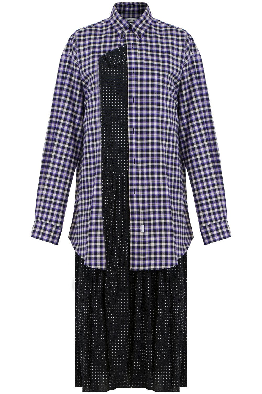 aa6bc03e00fd The Balenciaga Mini Polka Dot Shirt Dress is an oversized shirt dress  crafted from a mix