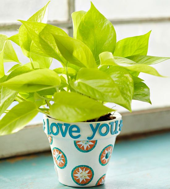 Flowerpot:Help kids decorate a flowerpot for an easy gift or a personalized way to grow a favorite bloom. Paint a pot in a color of choice. Create a fun border message by applying letter stickers around the top. Punch shapes from patterned paper to add as embellishments. Use decoupage medium to attach the punched shapes. Once they're dry, add epoxy accents.