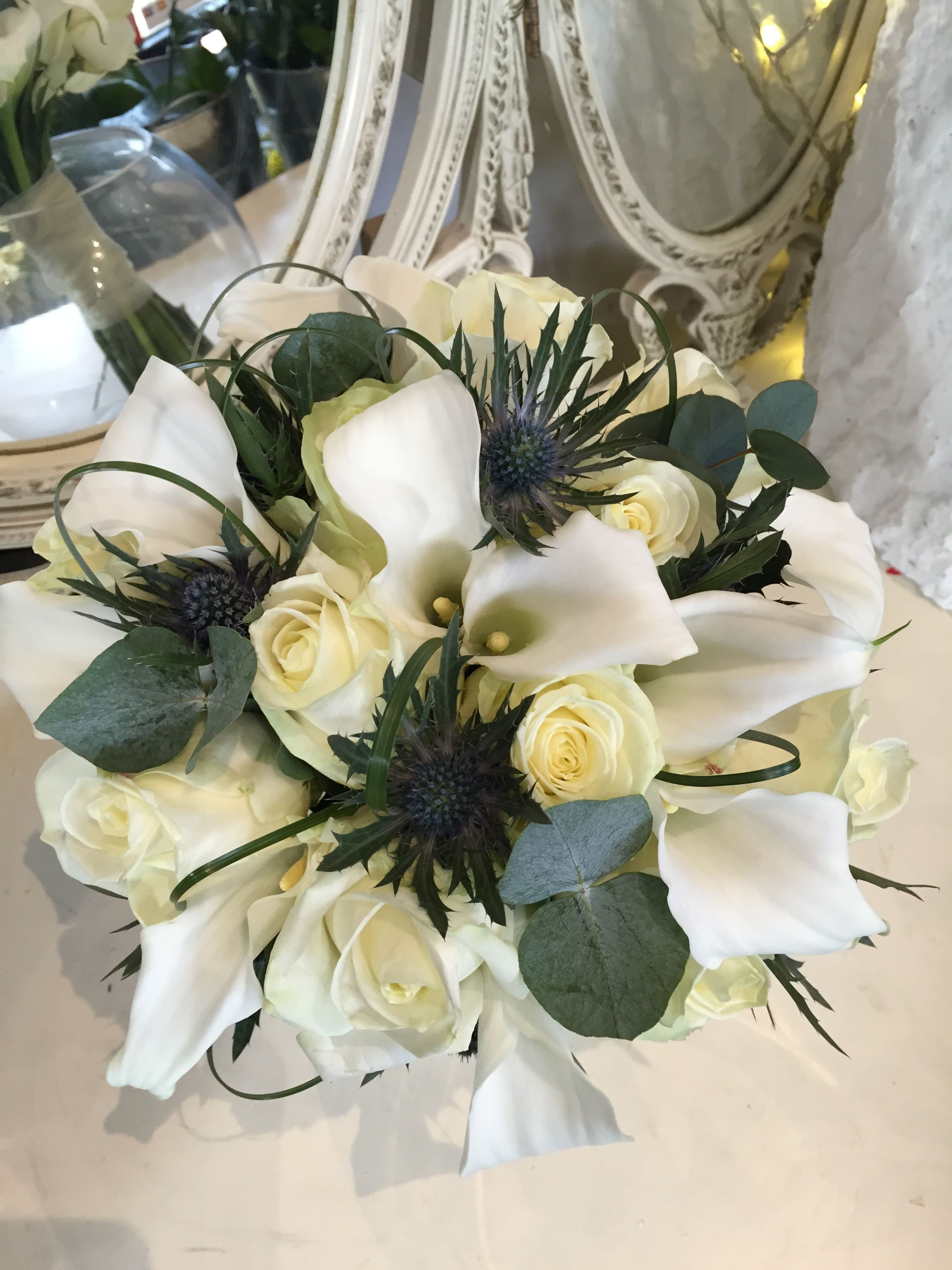 Ivory calla lily, rose and blue thistle Bridal bouquet