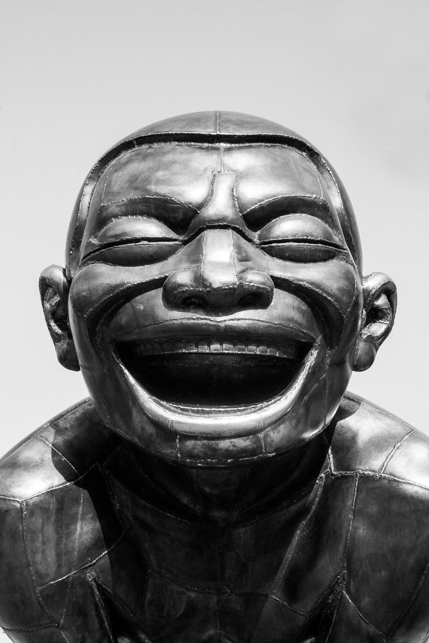 Photograph Black and White Bronze Sculpture of Laughing