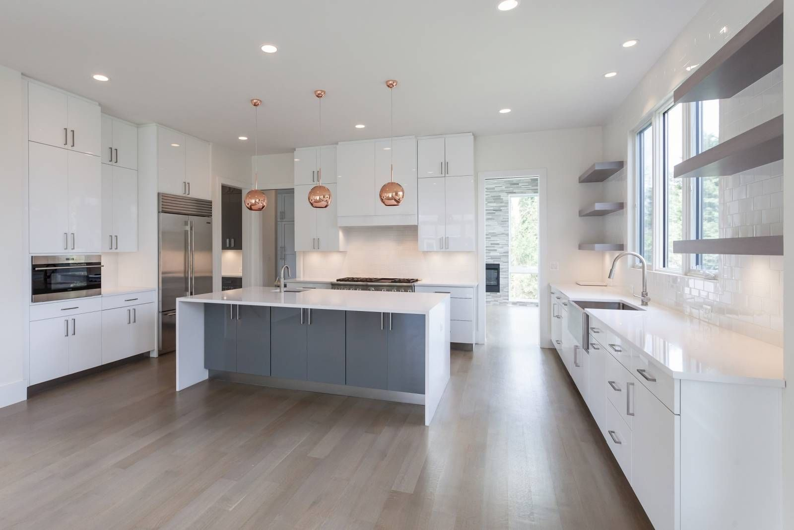 Modern Kitchen With White High Gloss Slab Cabinets Copper Pendants And Contrasting Gray Island With Wa Contrasting Kitchen Island Condo Kitchen Kitchen Decor