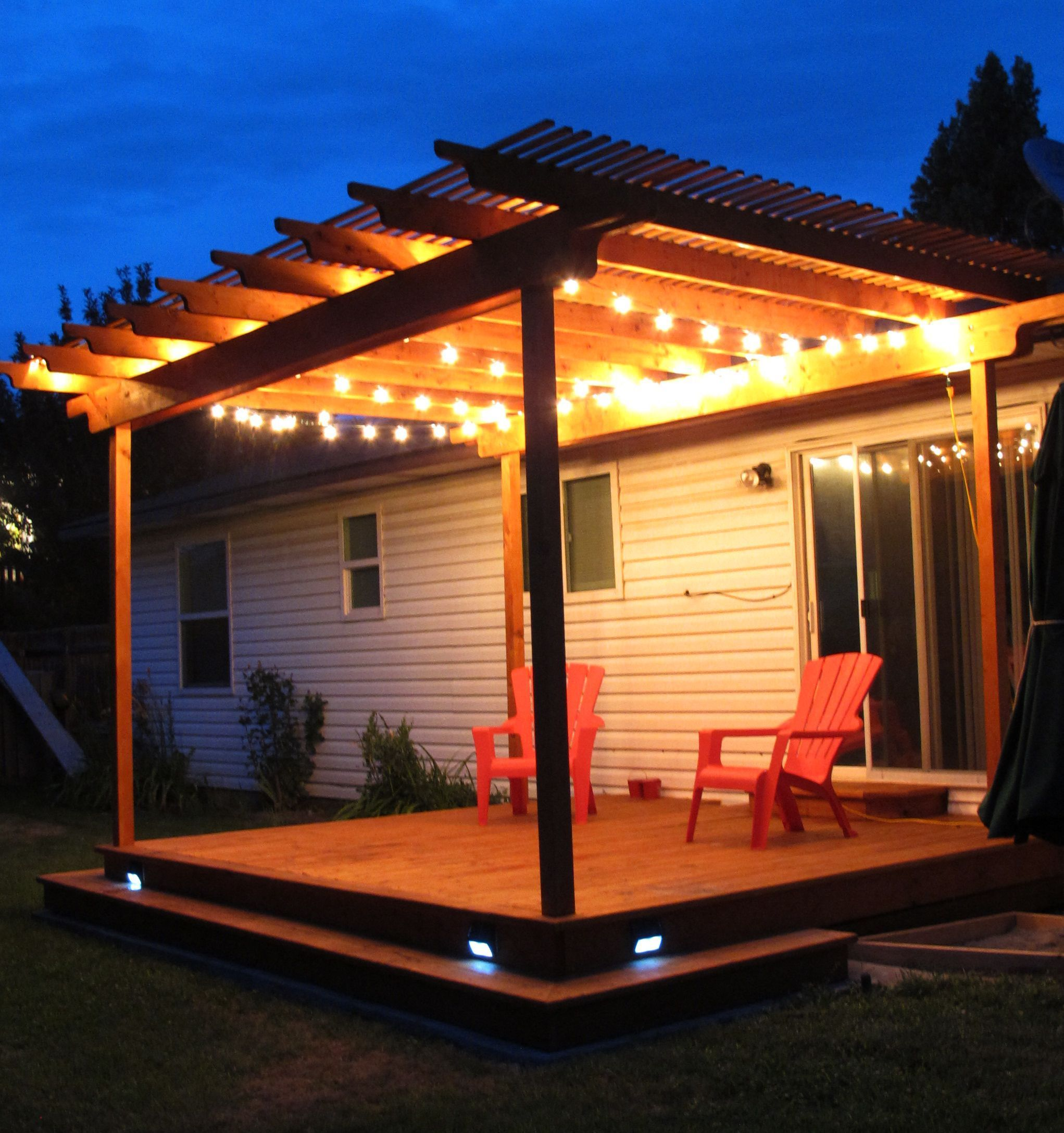 Awesome Pergola Deck With Wraparound Step And Strand Lighting It Also Has Solar Powered Stair Lighting This House Diy Outdoor Lighting Pergola Patio Pergola