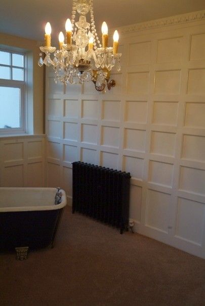 Full height panelling against cast iron radiator and Victorian bath ...