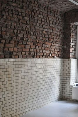subway tiles on exposed brick wall