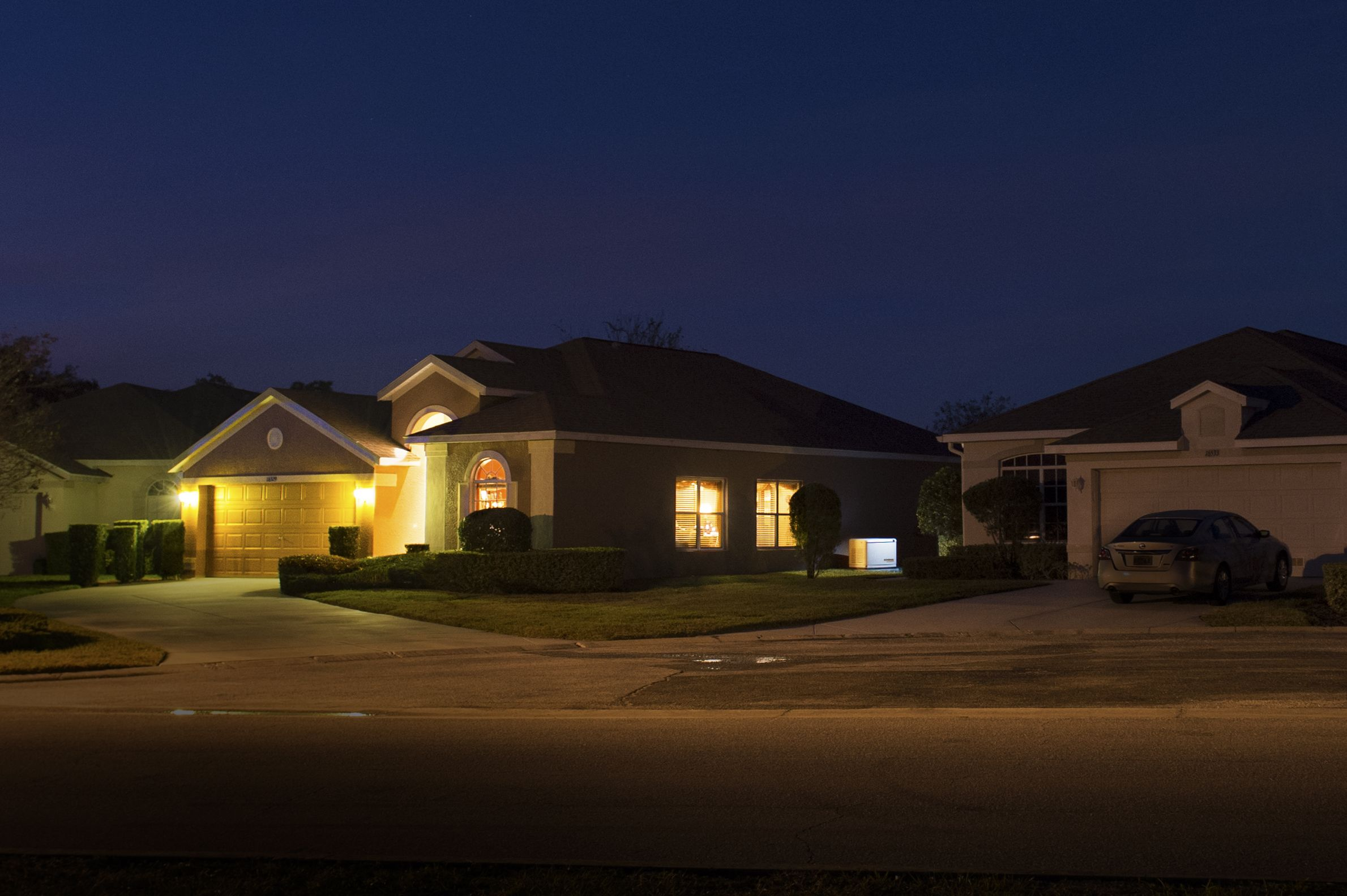 The neighborhood is dark but not the home with a Generac generator