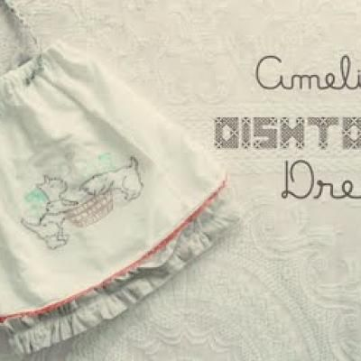 SO CUTE! DIY dishtowel dress tutorial for a little girl but i think it would make a great decor piece!