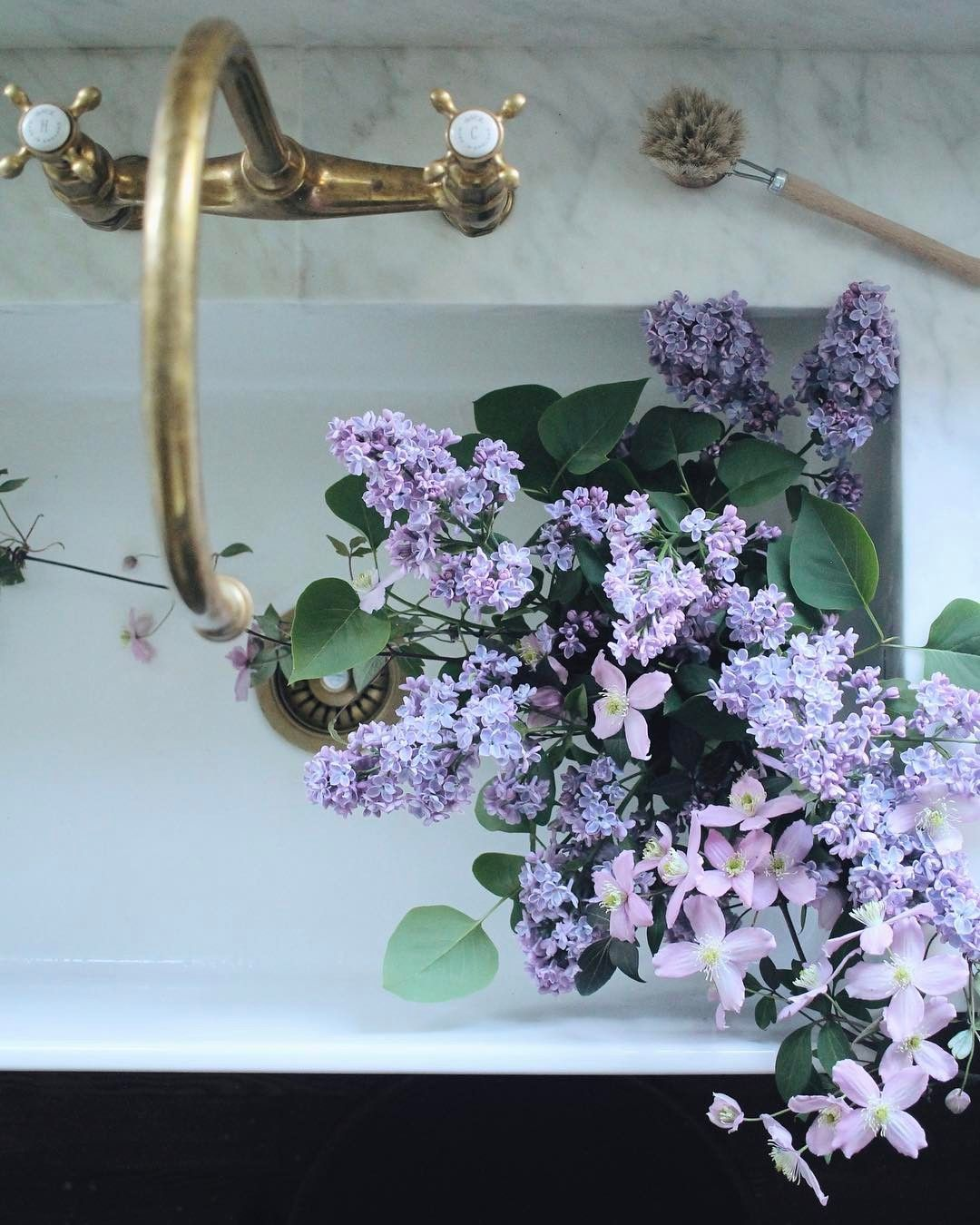 Lilacs and clematis from the garden. It feels so good to be home ...
