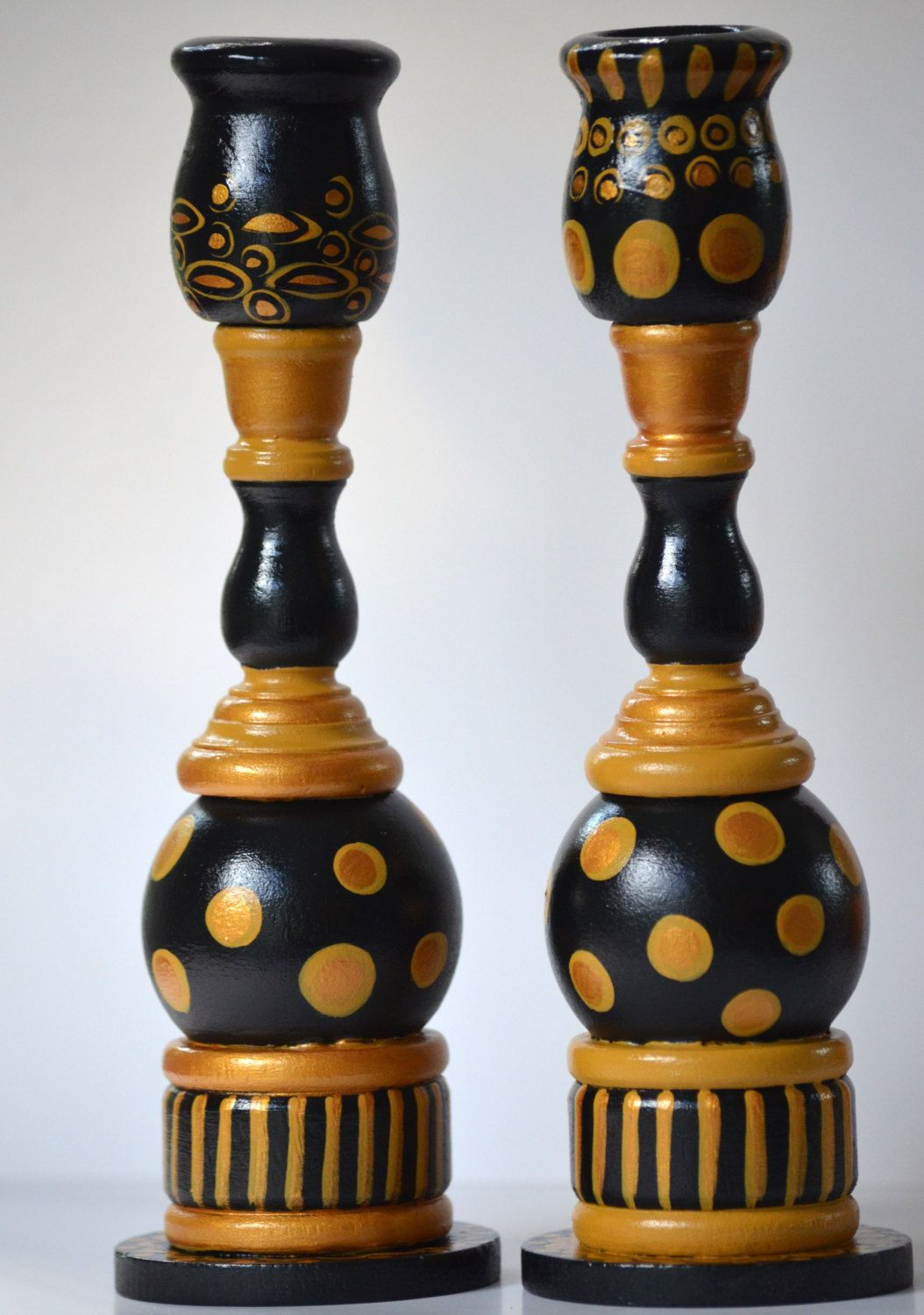 Set of two handpainted black and gold art deco candlestick holders