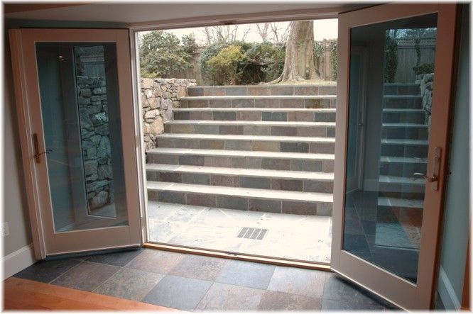 Westchester ny design build walk out french doors basement for Basement entry ideas