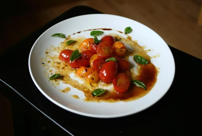 Warm cherry tomatoes via JSOnline. I made this tonight with tomatoes from the yard--delicious!
