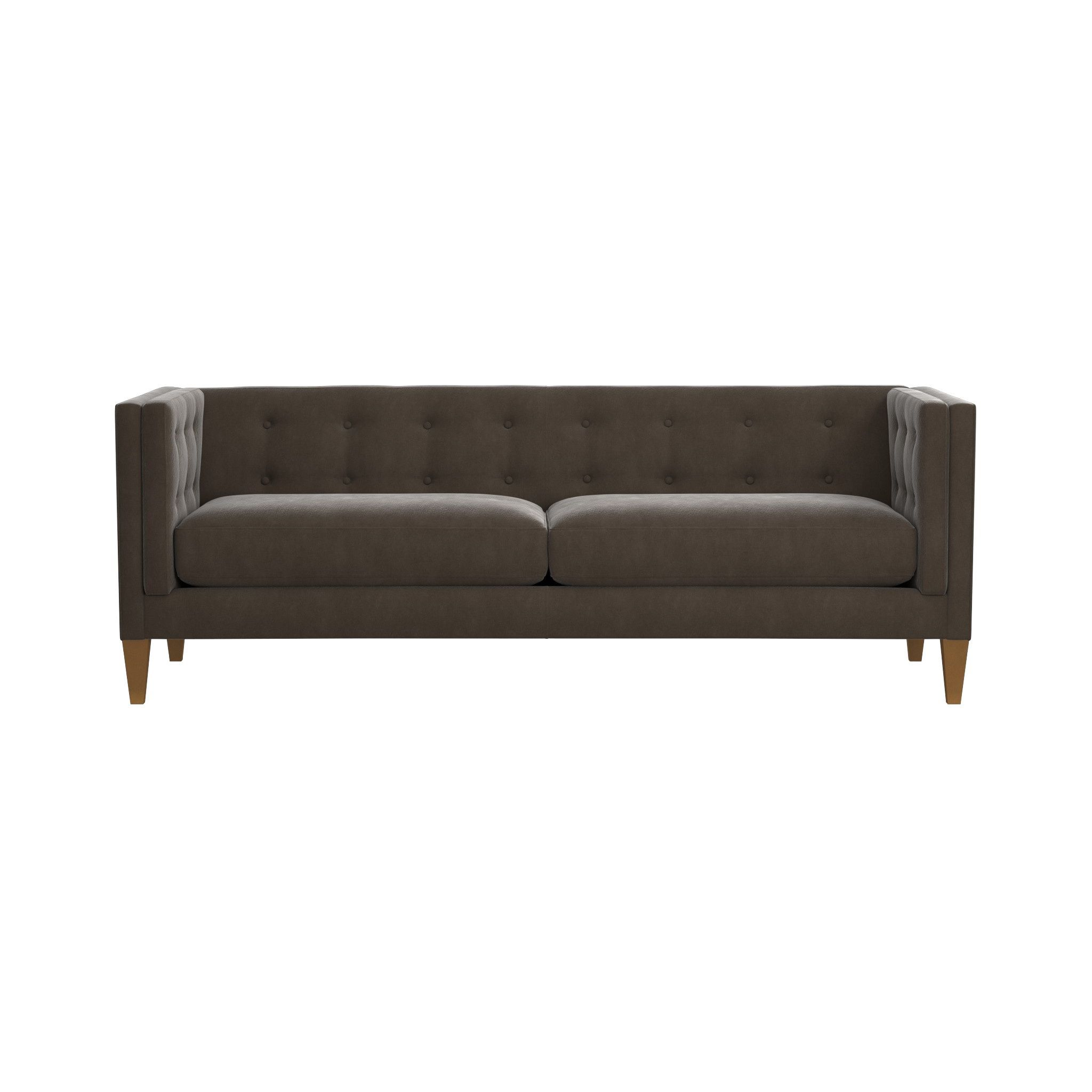 This boutique style sofa features a soft continuous button tufted back and two firm seat cushions the aidan velvet tufted sofa is a crate and barrel