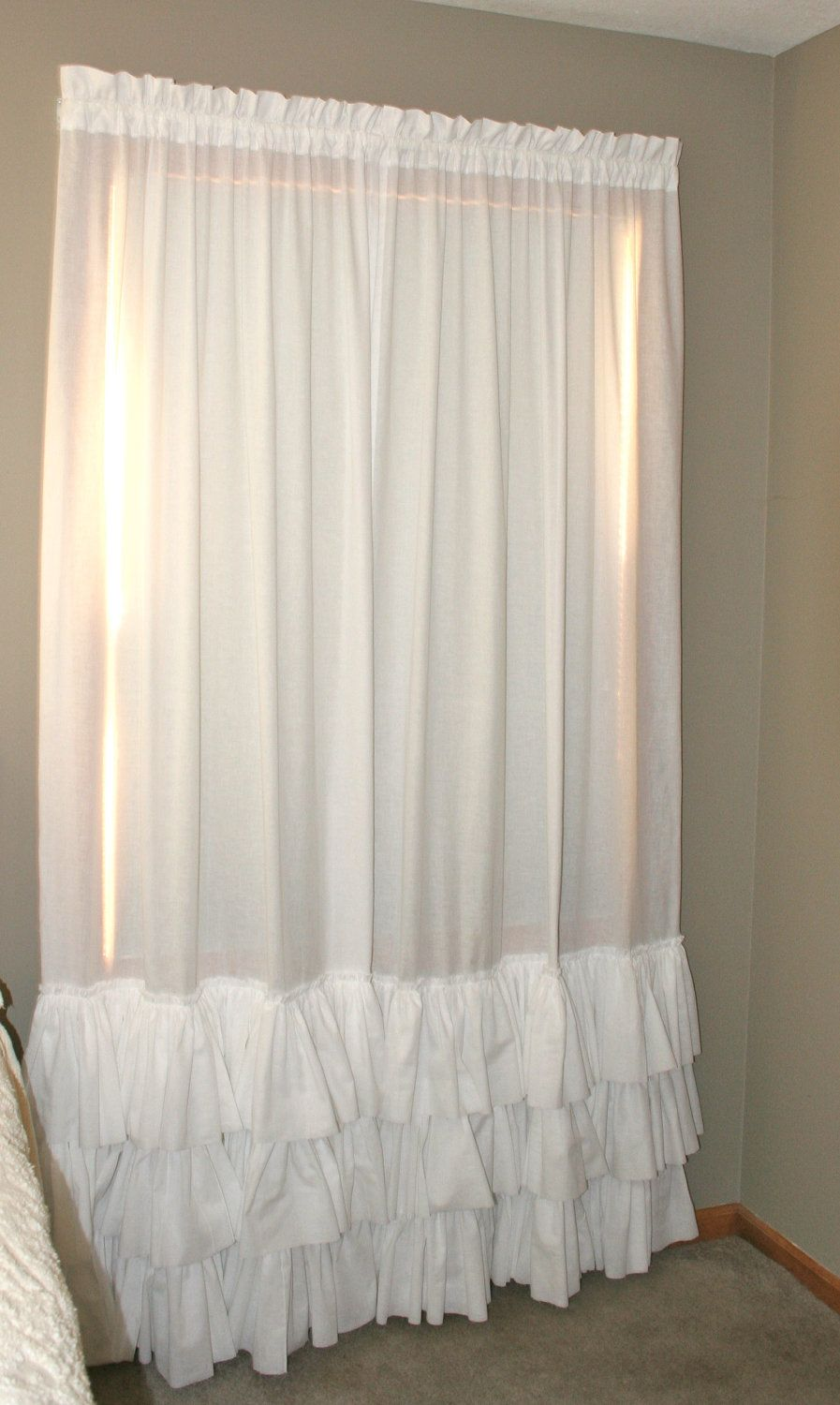 Bed against window with curtains  panels  curtains  window treatment  white triple ruffle pair