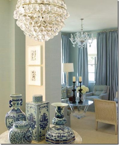 Classic Collection of Blue & White Porcelain on Table in Luxe French Blue Room