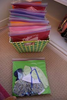 Getting Organized - Doll Clothes & Accessories - Cut construction paper to fit into a gallon size baggie.  Put one outfit on each side of paper, then file the baggie in a basket.