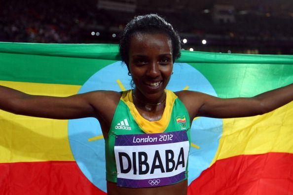 News Photo: Tirunesh Dibaba of Ethiopia celebrates winning gold in…
