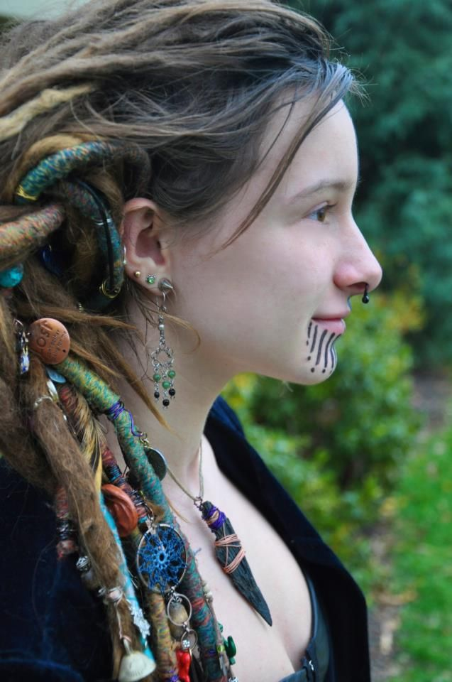 I like the assortment of things in her dreads...very unique.  The makeup is cool too.