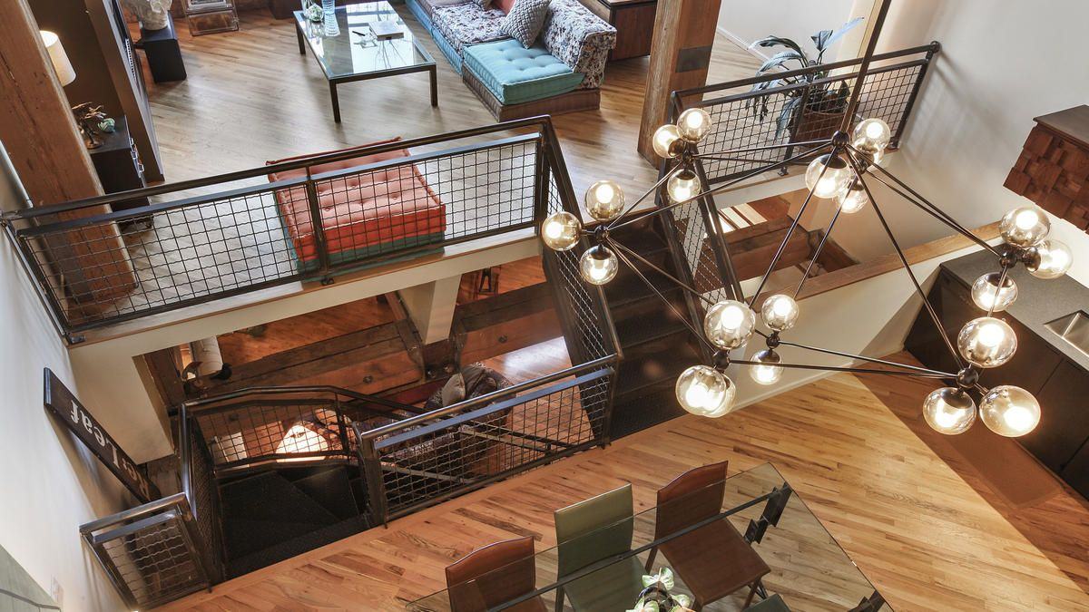 West Loop tri-level timber loft. Aerial view of living room, dining room