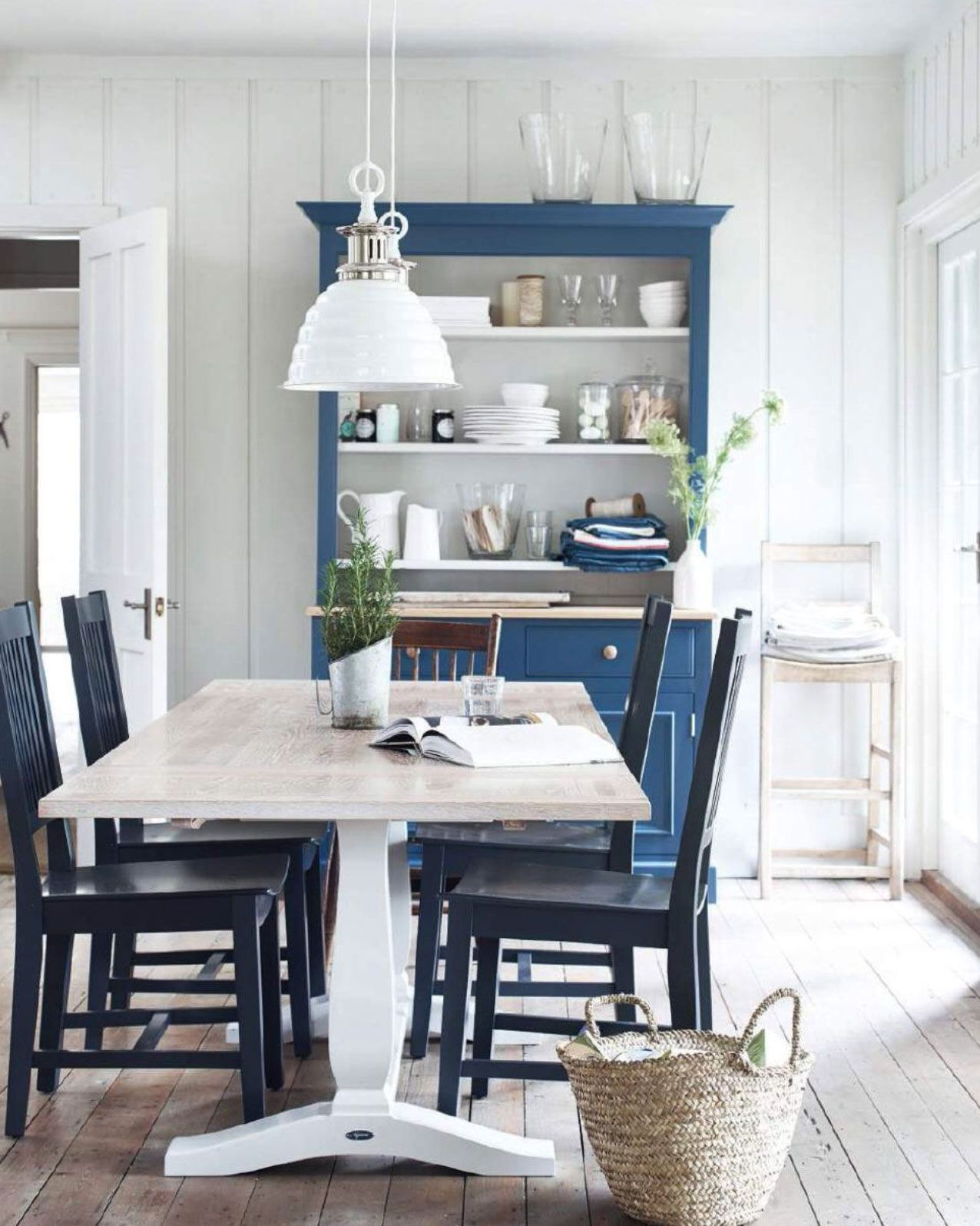 Charming White And Blue Country Dining Room. Bare Floorboards, White Painted Wood  Paneled Walls,