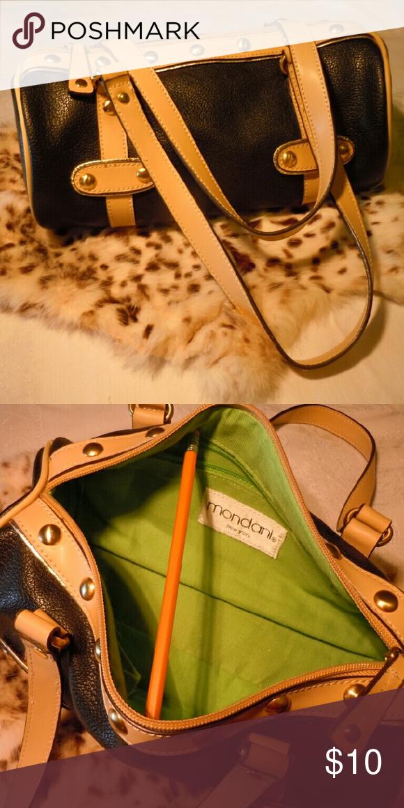 "Mondini New York barrel purse like new!! Beautiful black and tan barrel purse, vegan leather, stud details clean in and out. 11"" long, 5"" diameter. EUC Mondini New York  Bags"