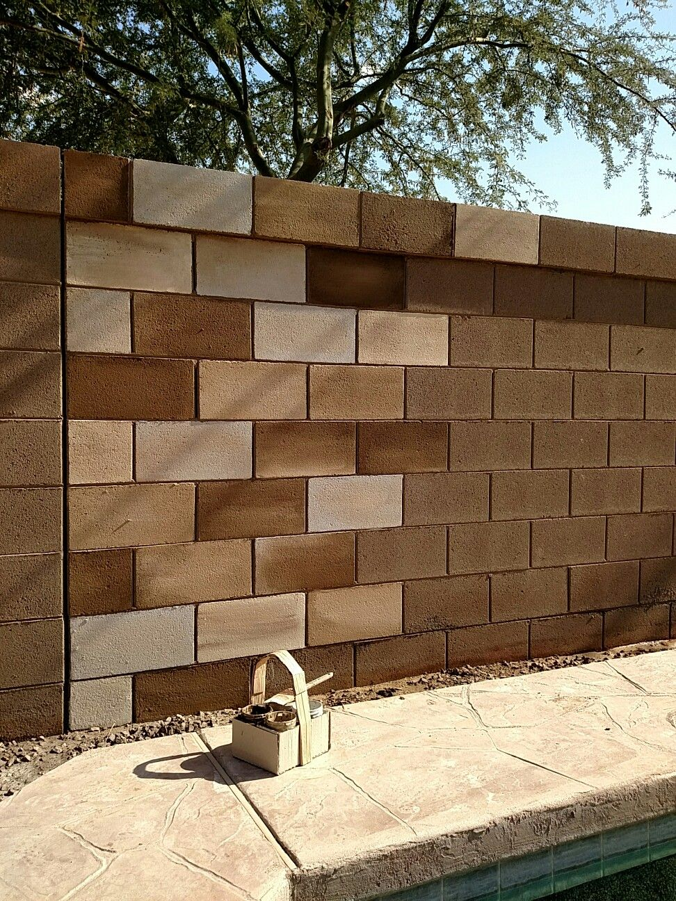 Painting a cinder block wall gives it a really cool effect, I love these  contrasting browns!