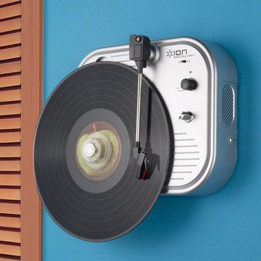 Serious gift idea: Wall-mounted turntable. Functional and allows you to display your vinyls.