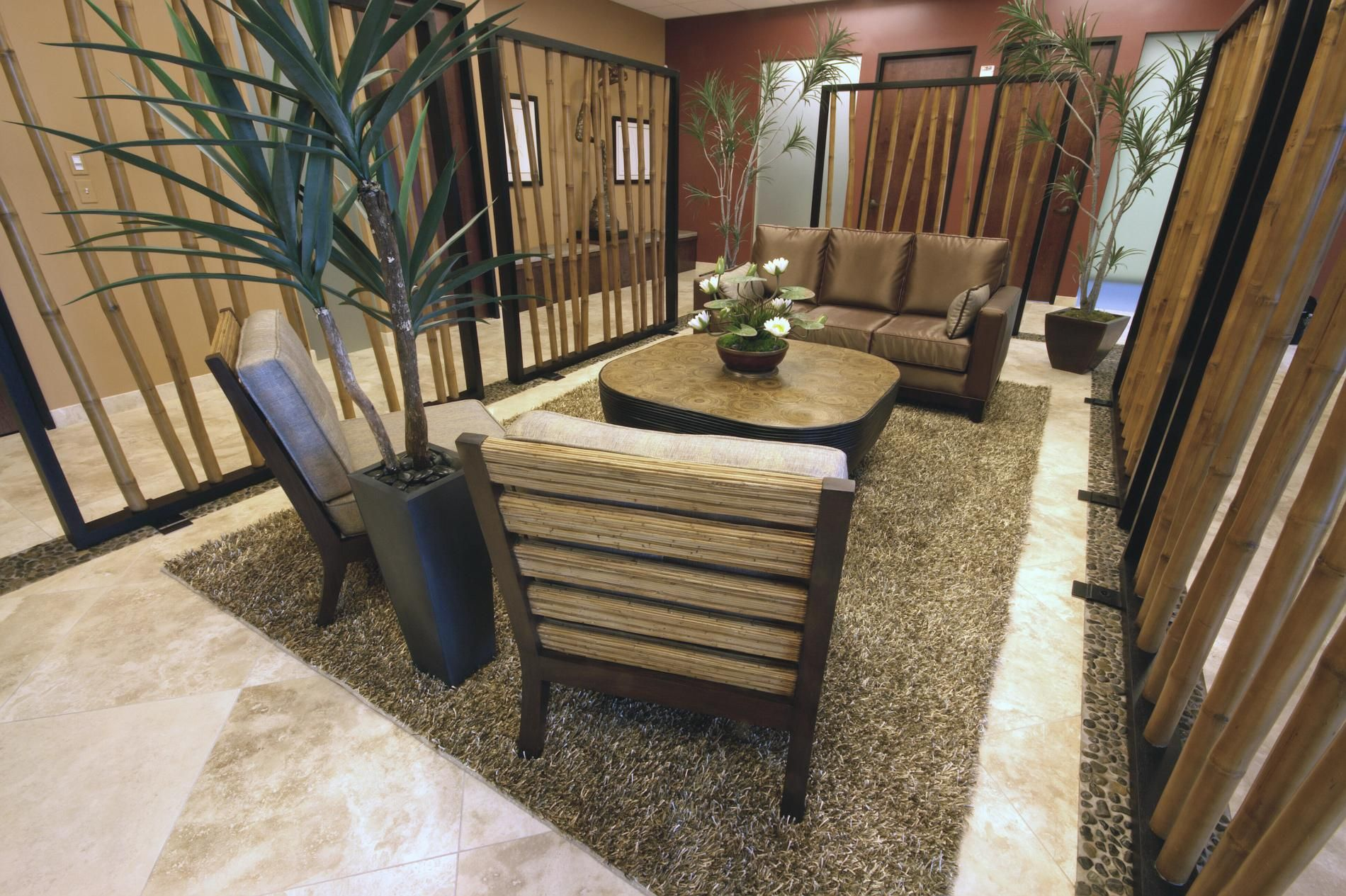 bamboo screen walls and a pebbled stone border physically and