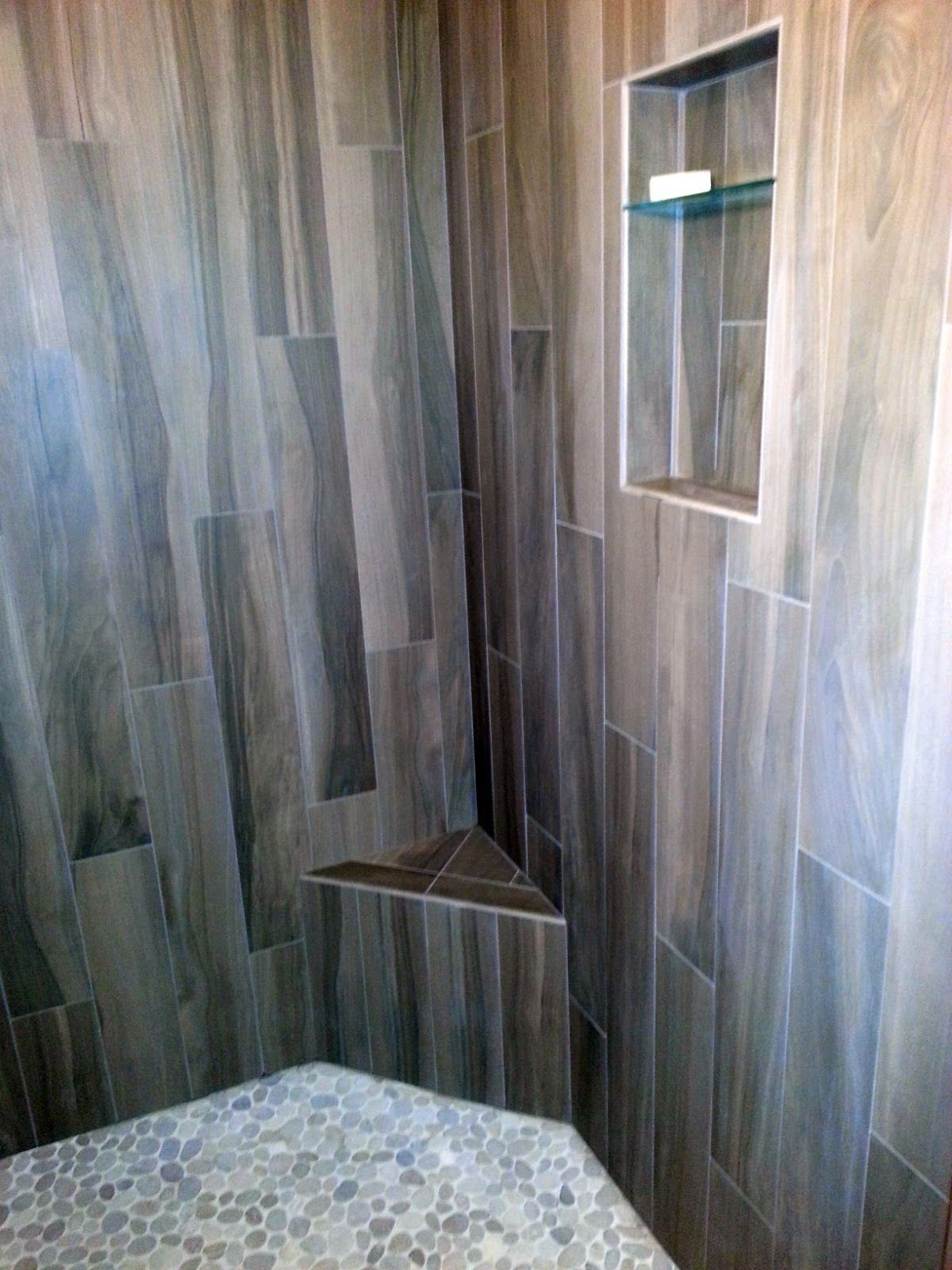 Light color wood tile with dark hardware and pebble floor - Light Color Wood Tile With Dark Hardware And Pebble Floor Shower