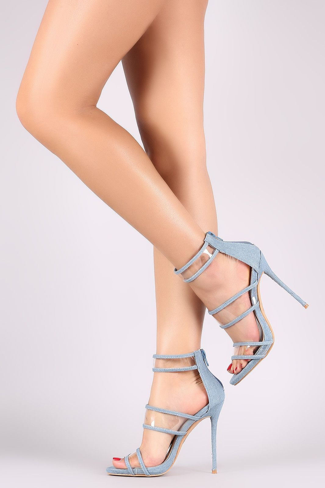 This gorgeous heel features an open toe silhouette, triple clear straps with denim trim, and slim stiletto heel. Finished with a lightly padded insole and rear zipper closure for easy on/off. Material