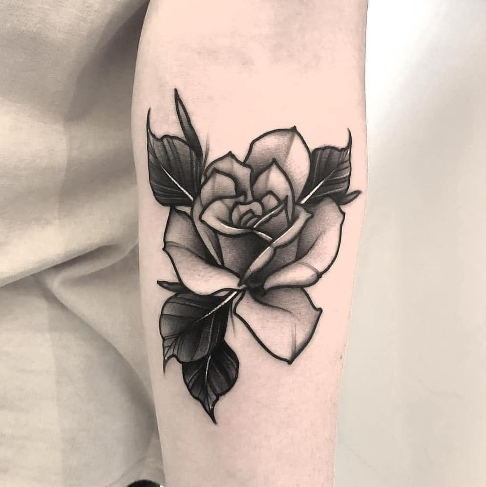 Photo of Perfect black and grey rose tattoo inked on the left forearm