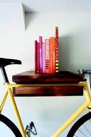 store bike on wall - clever wall art!