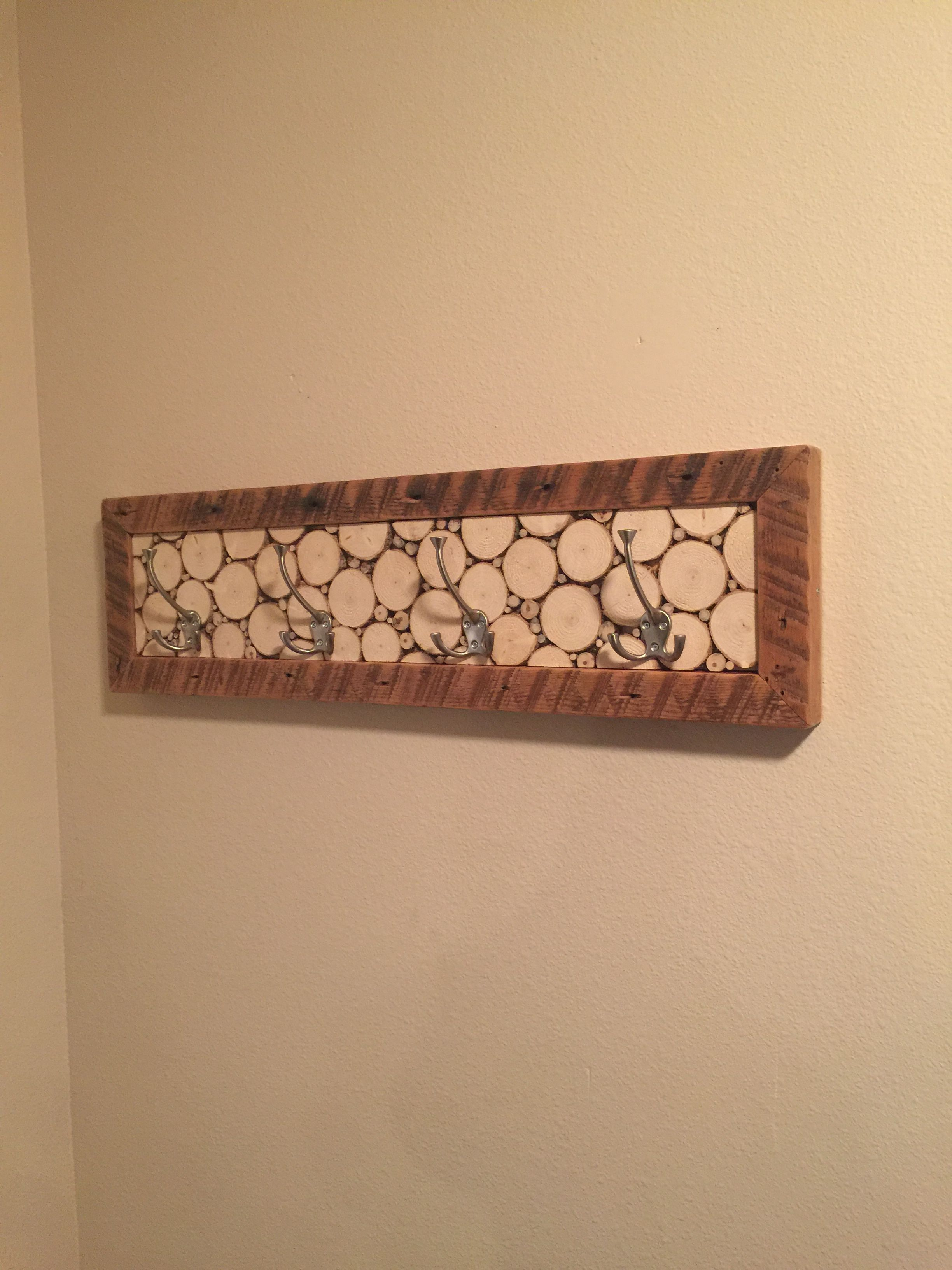 Coat rack spruce tree discs framed by the edges of old xs made