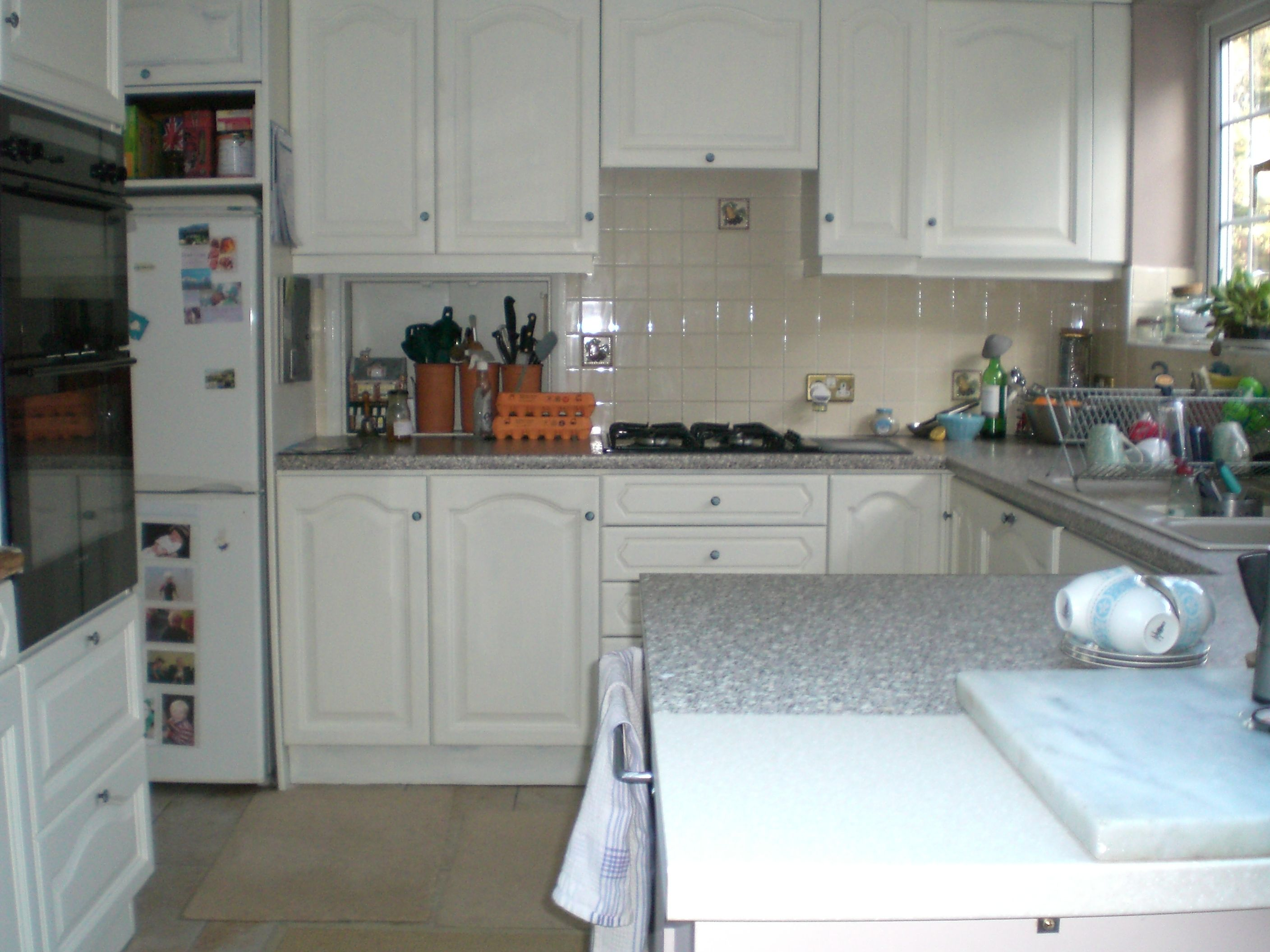 after - painted cupboards look fab