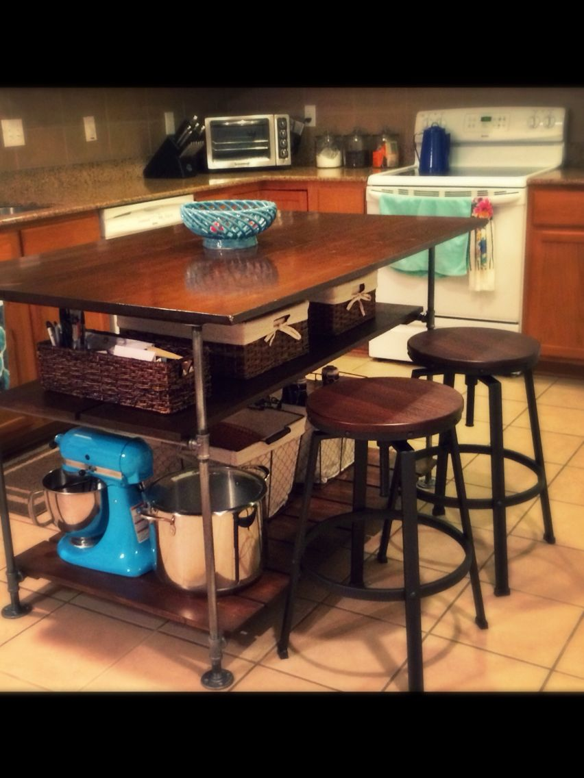 how to build a butcher block island gas pipe block island and made a kitchen island out of pine boards and galvanized steel piping for an industrial look