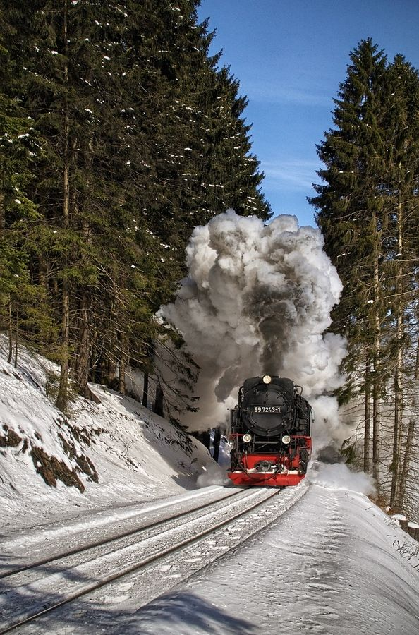 steam train on rails winter snow smoke railway tracks