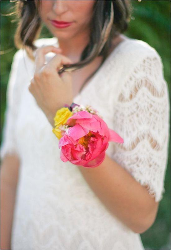 Casual yet bright wrist corsage idea for bride. --- http://www.weddingchicks.com/2014/05/27/wearable-floral-art/