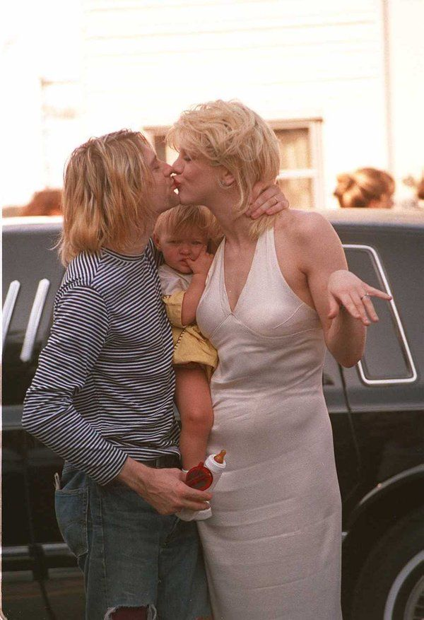 Kurt Cobain (left) with Courtney Love and Frances Bean in L.A., 1993.