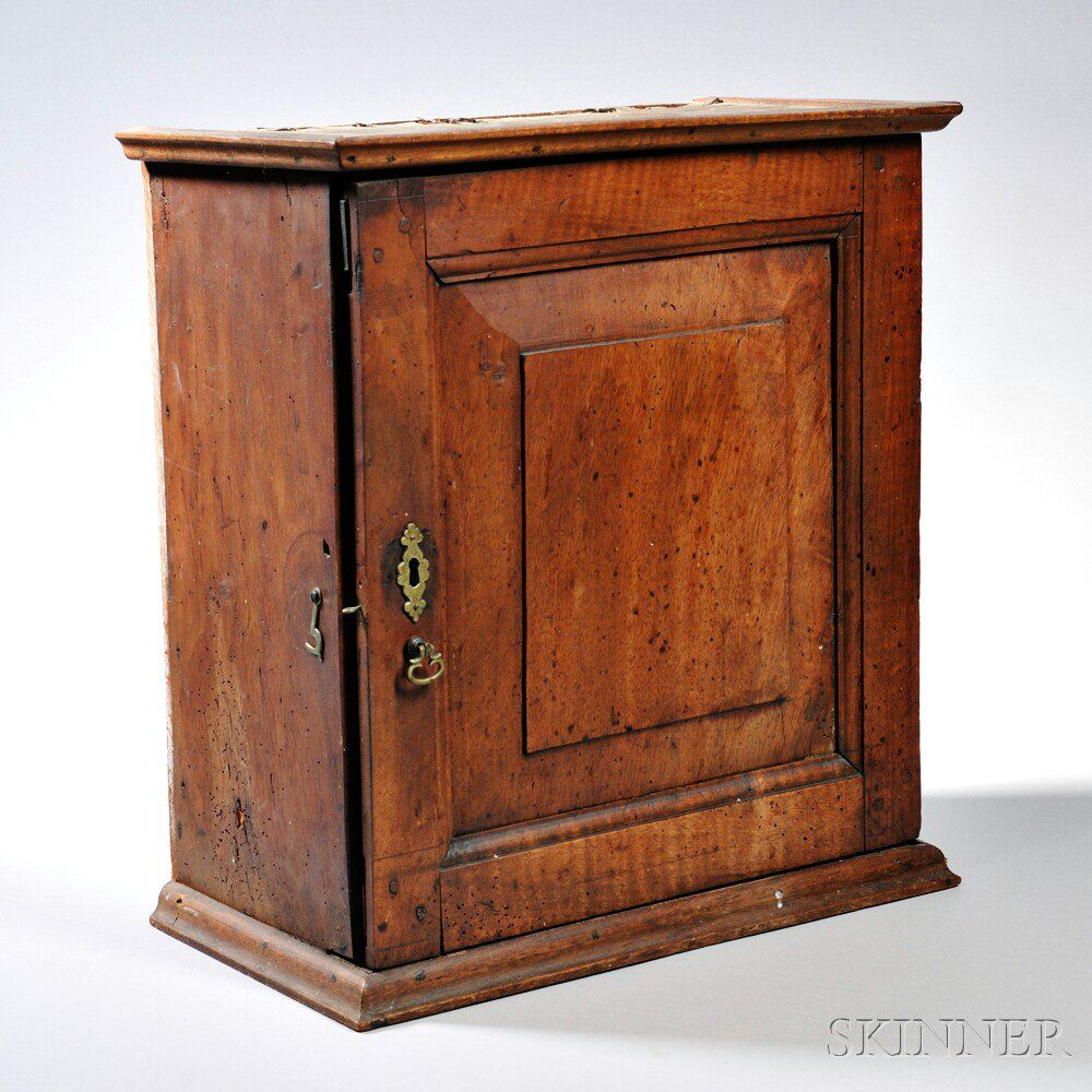 Walnut Spice Cupboard Late 18th Century The Molded Cornice Above A Hinged Raised Panel Door Opening To Seven Draw Cupboard Wall Cupboards How To Antique Wood