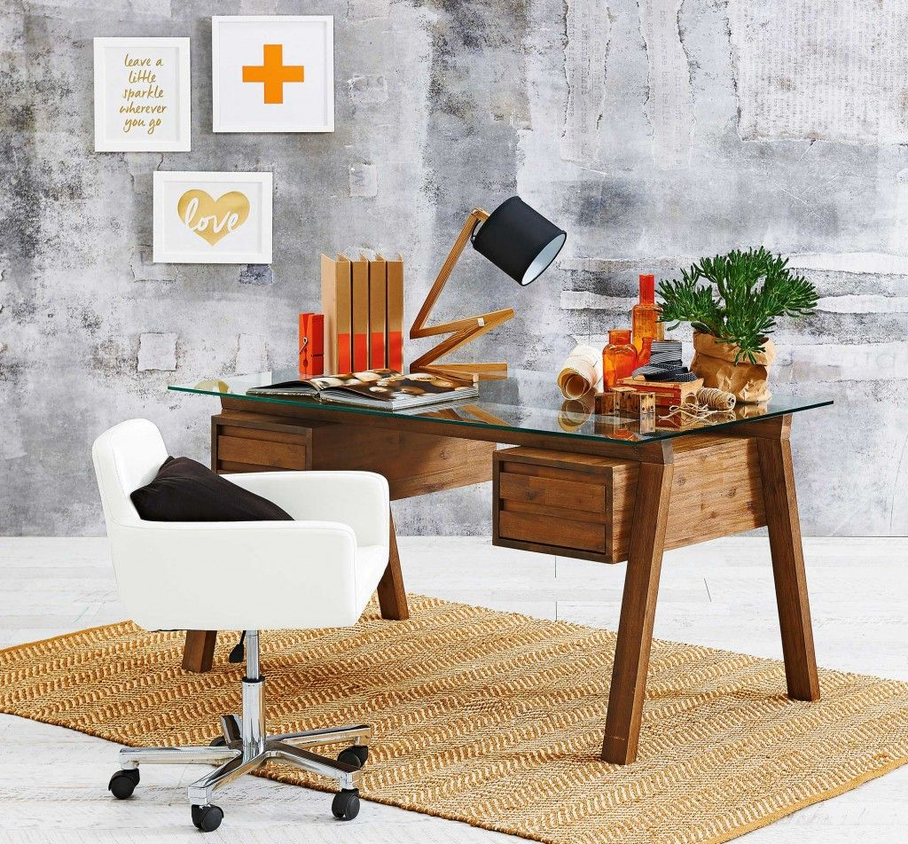 a beautiful desk with storage and a glass top the desk