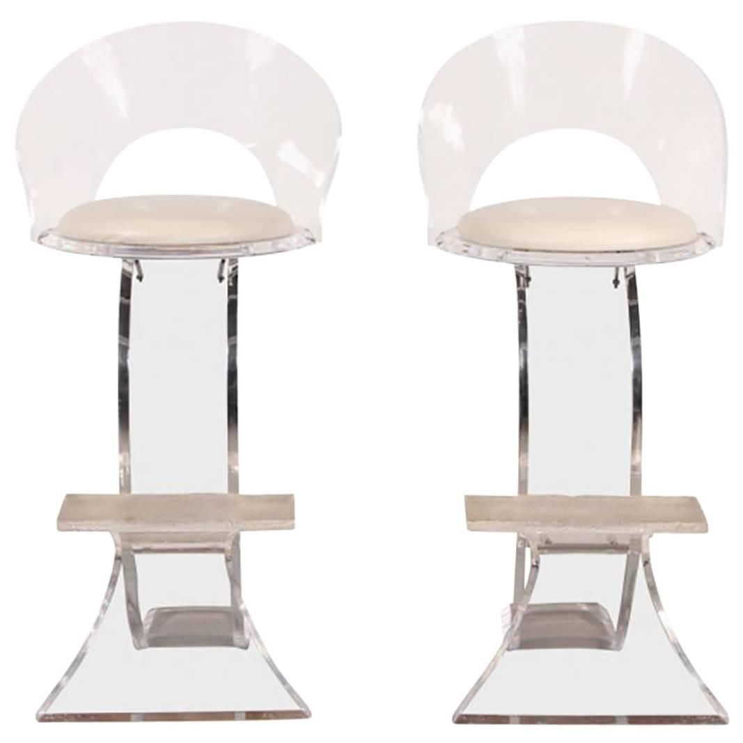 Pair of lucite counter stools with off white leather upholstery