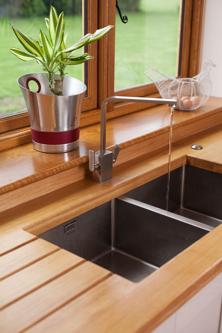Of storage both behind the worktop amp cooker and below the sinks - Full Stave Prime Oak Worktops Are A Most Elegant Choice For Any Kitchen In This Kitchen The Customer Requested Worktops With An Undermounted Sink Cut Out