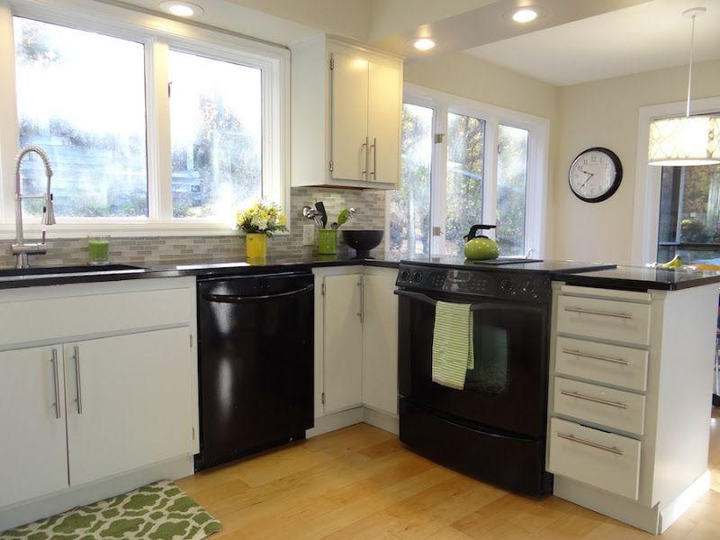 Black appliances white cabinets light gray backsplash