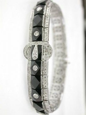 Art Deco One 18 karat white gold buckle art deco-style bracelet. Twenty-seven facetted onyx. Six round brilliant cut diamonds (0.38 carats: SI2 clarity: G-H colour). 239 round brilliant cut diamonds (2.45 carats: SI clarity ~ETS