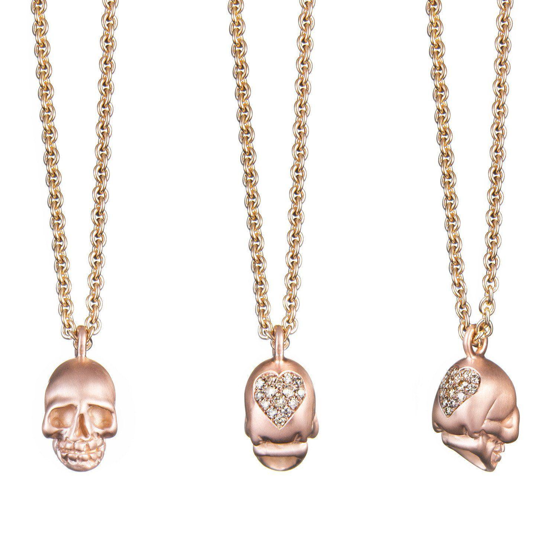 Large satin finished k rose gold skull pendant set with a pave