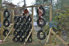 The DIY tire climbing wall. Made from junk yard tires, wood beams, and rope.
