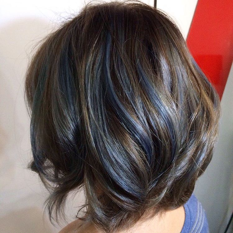 layered brown bob with blue streaks brown hair color