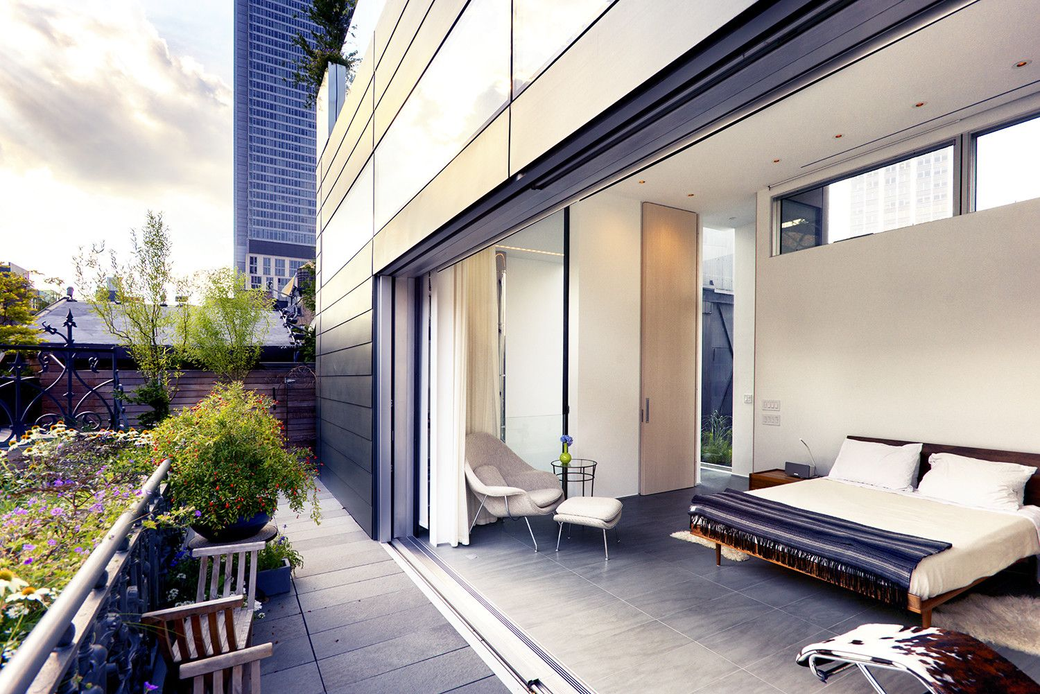 An Expansive Sliding Glass Door Retracts Into The Zinc Facade Opening Up Master Suite