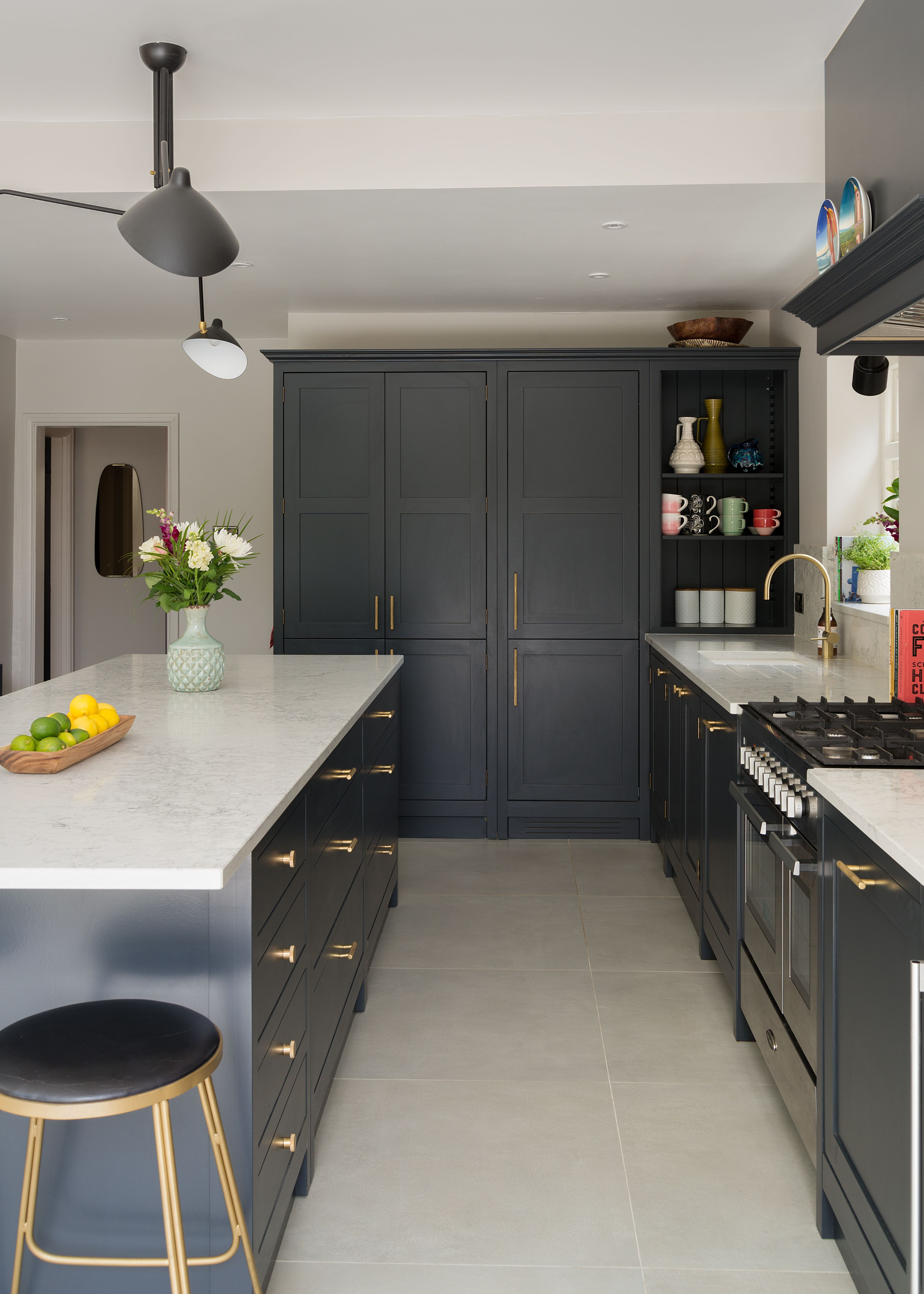 subtle mid century modern styling combined with bold hand painted grey cabinets create an i on kitchen cabinets modern contemporary id=12221