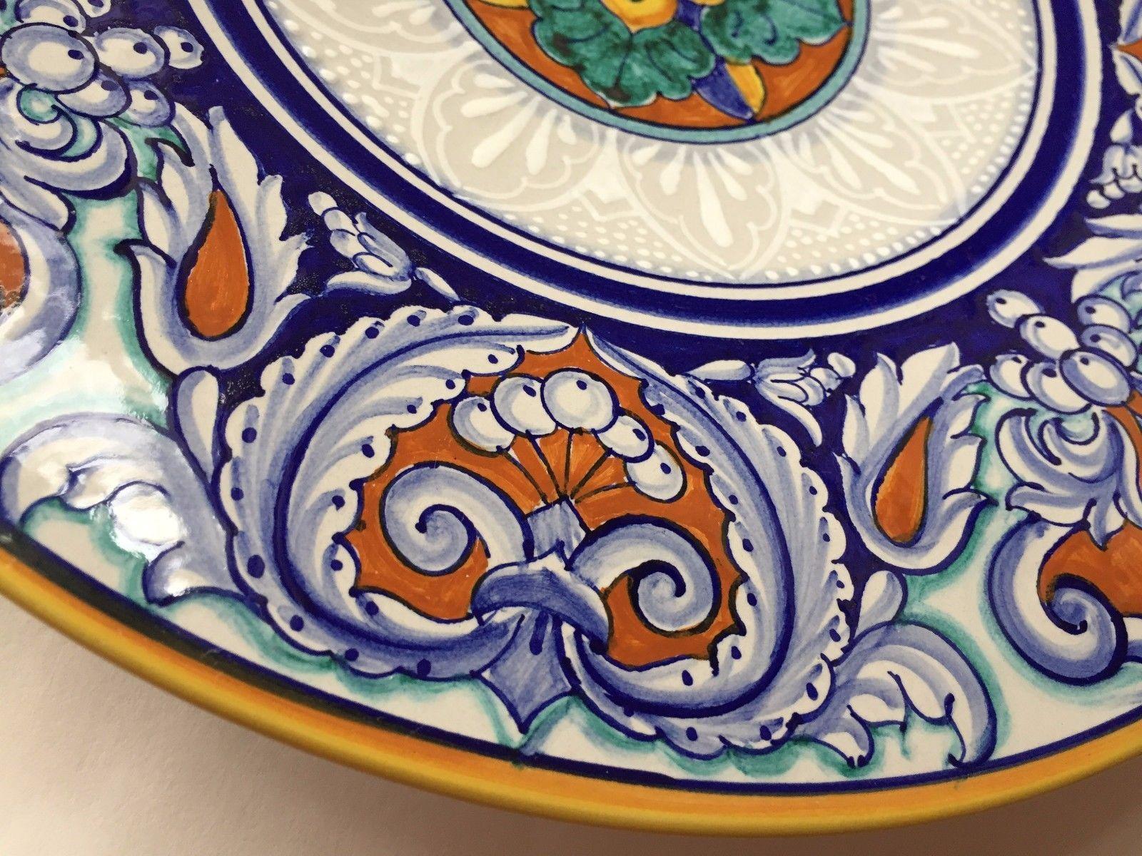 Piatto in ceramica deruta san mauro abate firmato su retro la