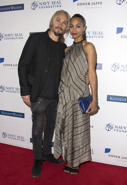 Zoe Saldana Photos Photos - Actress Zoe Saldana (R) and husband Marco Perego attend the 2017 Los Angeles Evening of Tribute Benefiting the Navy SEAL Foundation, on June 1, 2017, in Beverly Hills, California. / AFP PHOTO / VALERIE MACON - 2017 Los Angeles Evening of Tribute  Benefiting The Navy SEAL Foundation - Arrivals