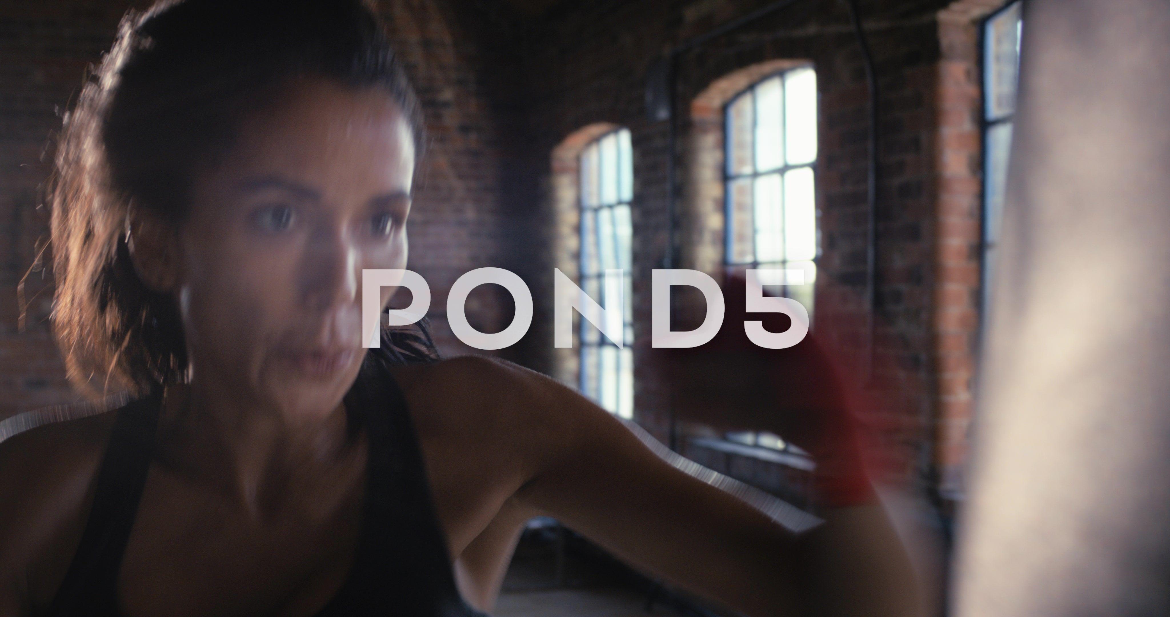 Kickboxing woman training punching bag in fitness studio Stock Footage,#training... -  Kickboxing wo...